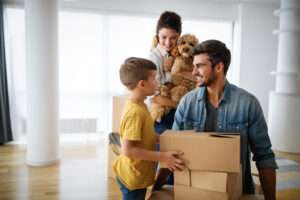 happy family with children moving with boxes in a 6D9R532 scaled